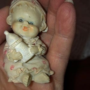 Vintage miniature baby with bottle, pajamas,
